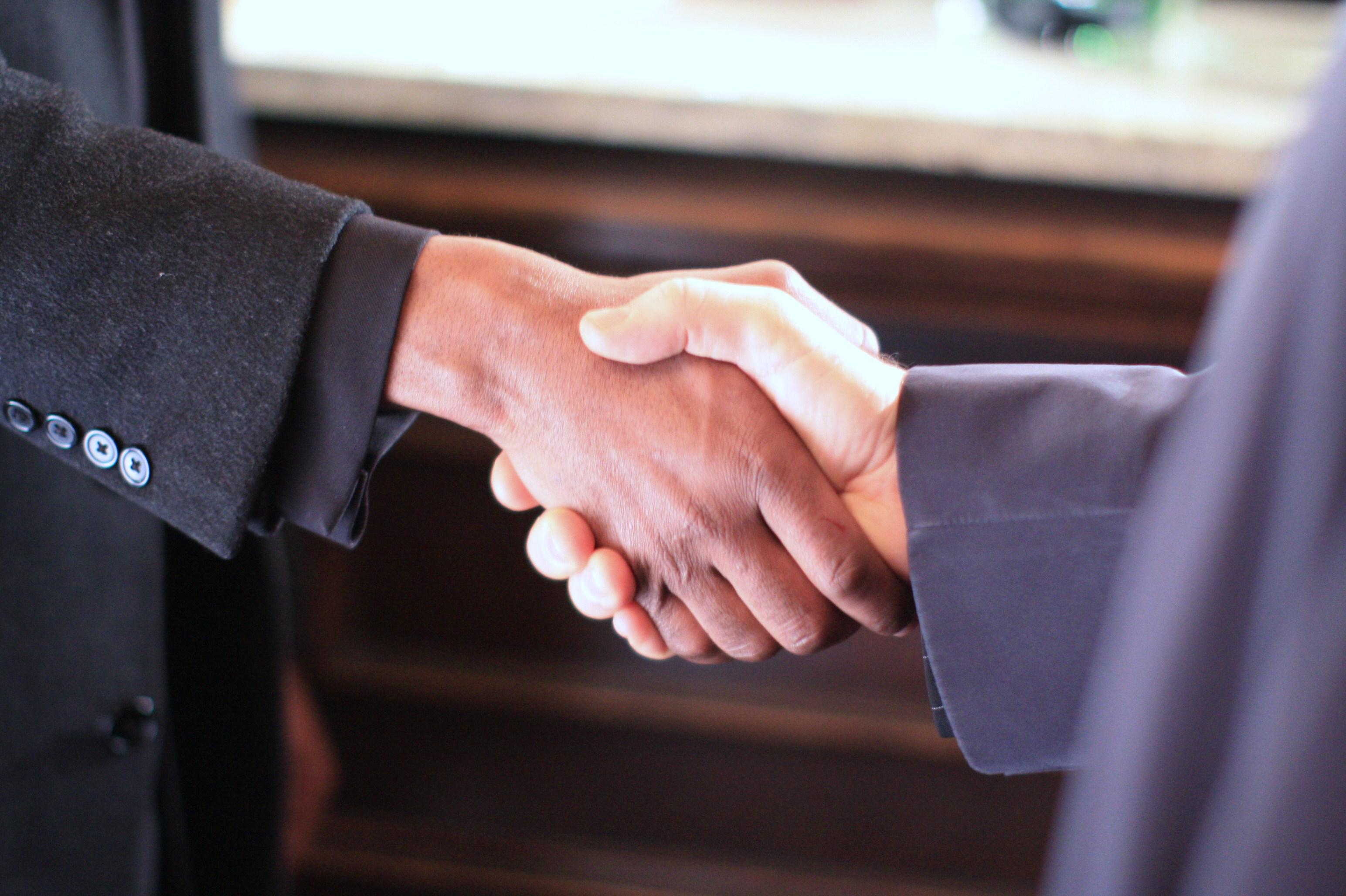 black__white_handshake_-_still_from_the_film_colour_blind_2009
